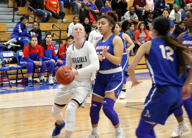 Carsyn Boswell drives to the lane during Monday's game against Americas. She finished with 24 points.