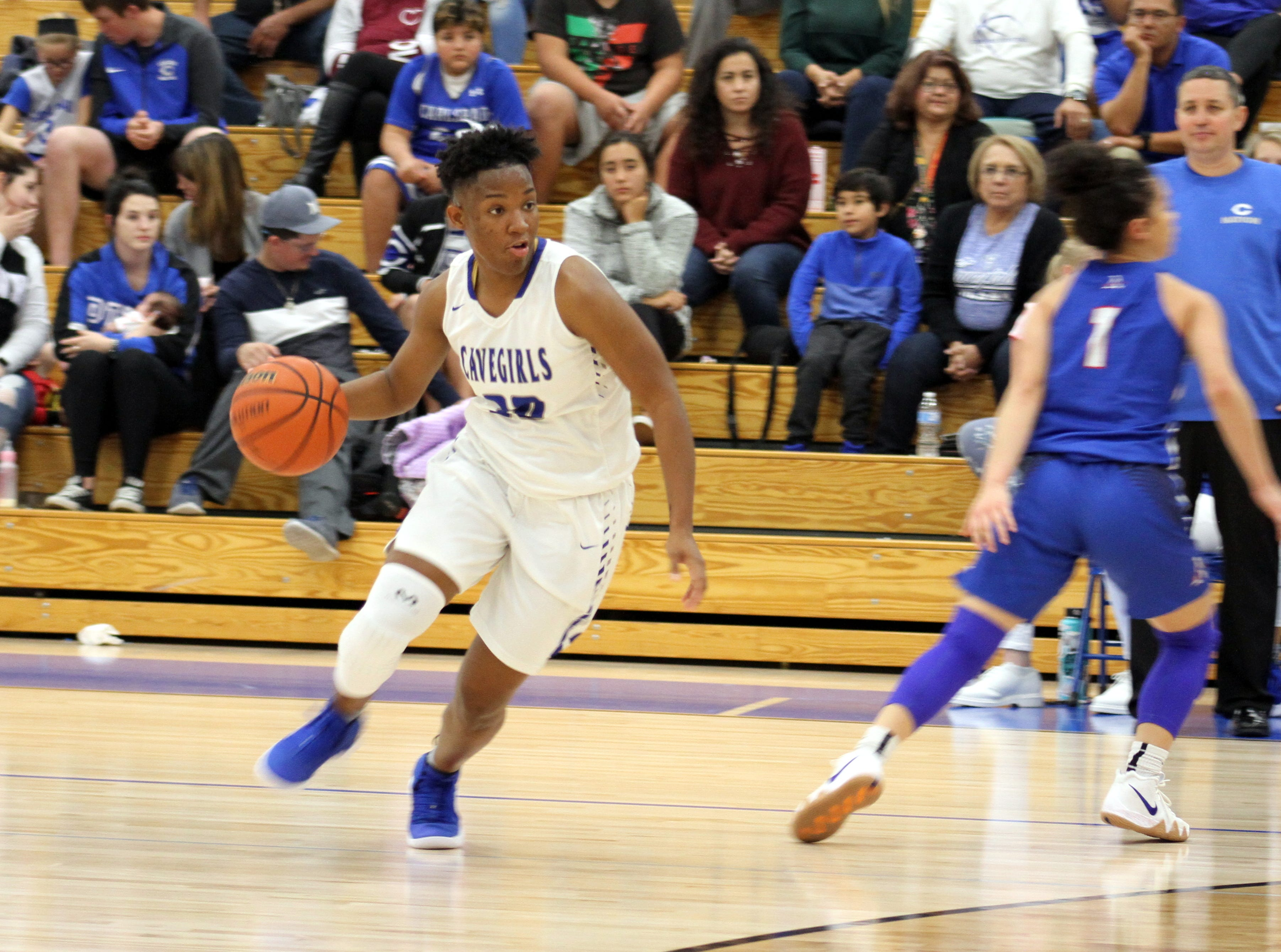 Dayshaun Moore looks to drive the lane during Monday's game against Americas. She finished with nine points.