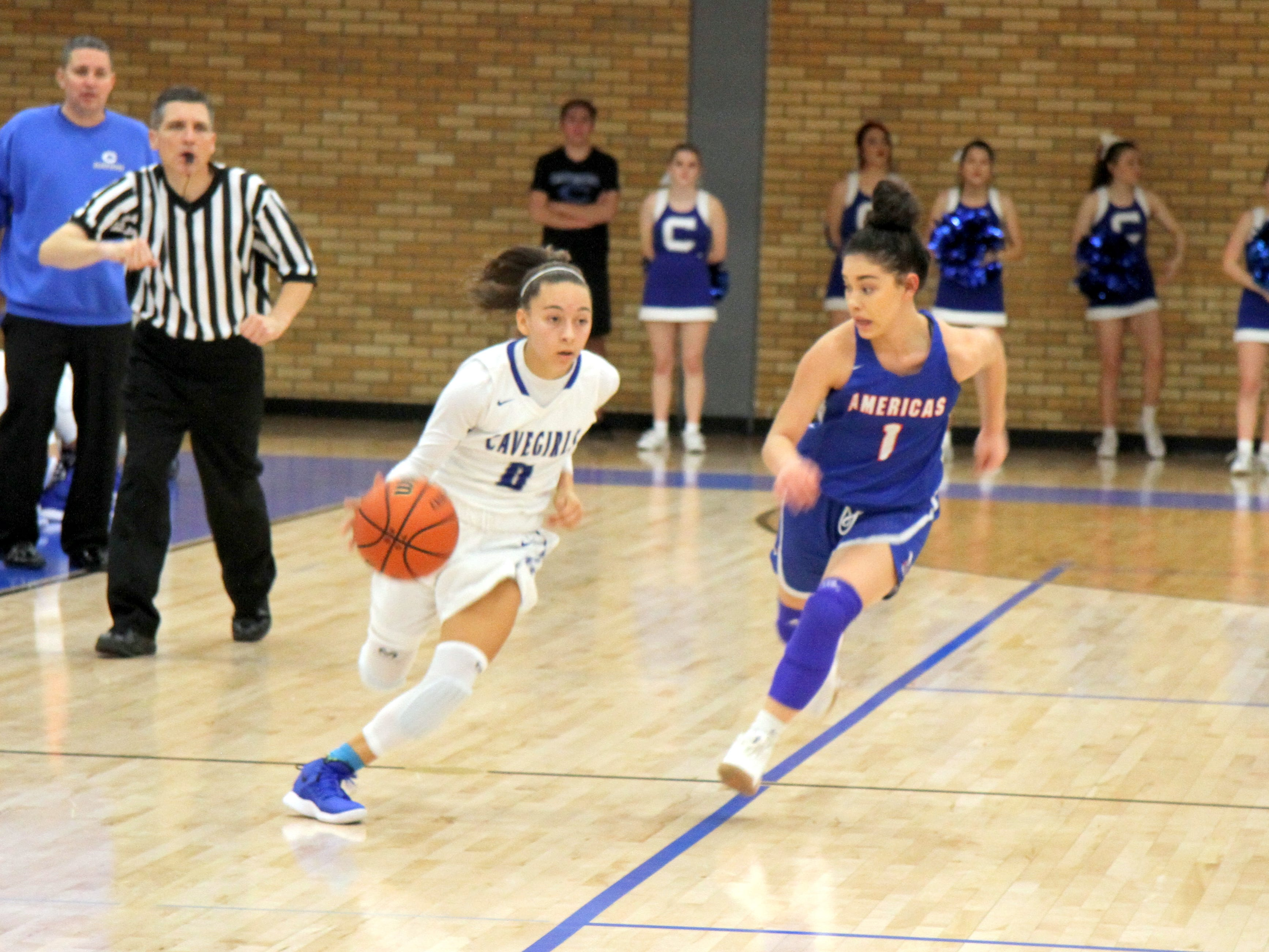 Baylee Molina sprints by a defender during Monday's game. Molina scored three points and had eight assists in Carlbad's win over Americas.