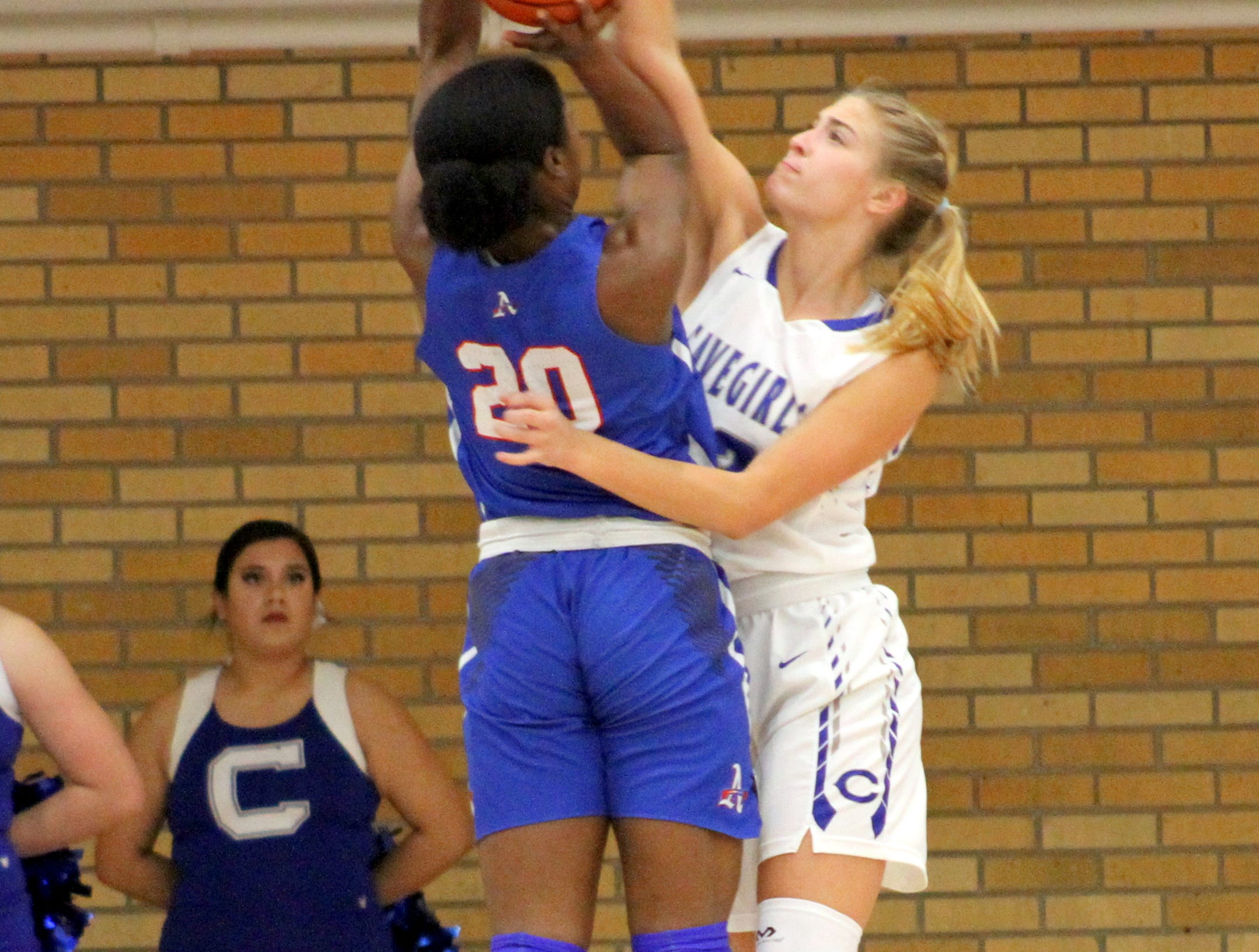 Carlsbad's Jordan Boatwright goes for a block against an Americas player during Monday's game.