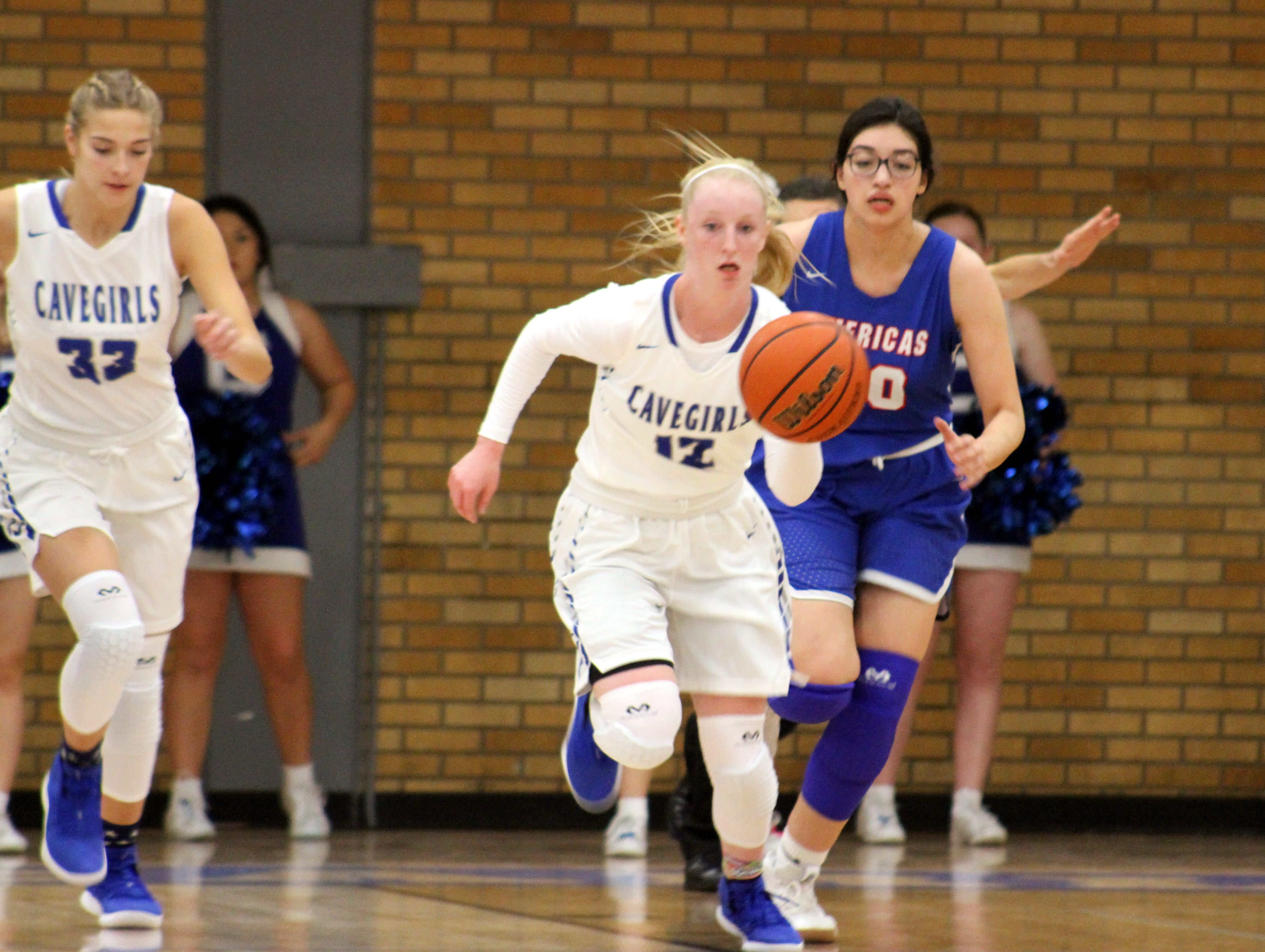 Carsyn Boswell starts a fastbreak during Monday's game against Americas.
