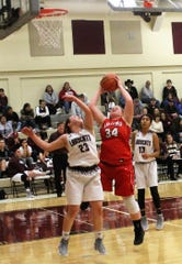Lady Wildcat senior Alex Leyva blocks the ball  at the Lady Wildcats' Dec. 1 home game against the Loving Falcons.