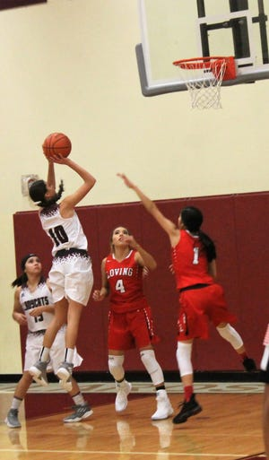 Tularosa senior Allysa Montoya scores on of her two field goals at the Lady Wildcats' Dec. 1 home game against the Loving Falcons.