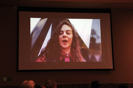 "Previous performances by Farmington High School junior Chevel Shepherd are projected onto screens inside the Farmignton Civic Center as fans wait for NBC's ""The Voice"" to begin Monday night. About an hour and a half into the show, they cheered when Shepherd took the stage and sang a Loretta Lynn classic."
