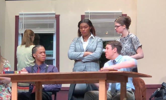 Farmington students (from left) Kamar Scaggs, Taja Carroll, Joe Smentowski, and Megan Cromwell discuss evidence from the trial.