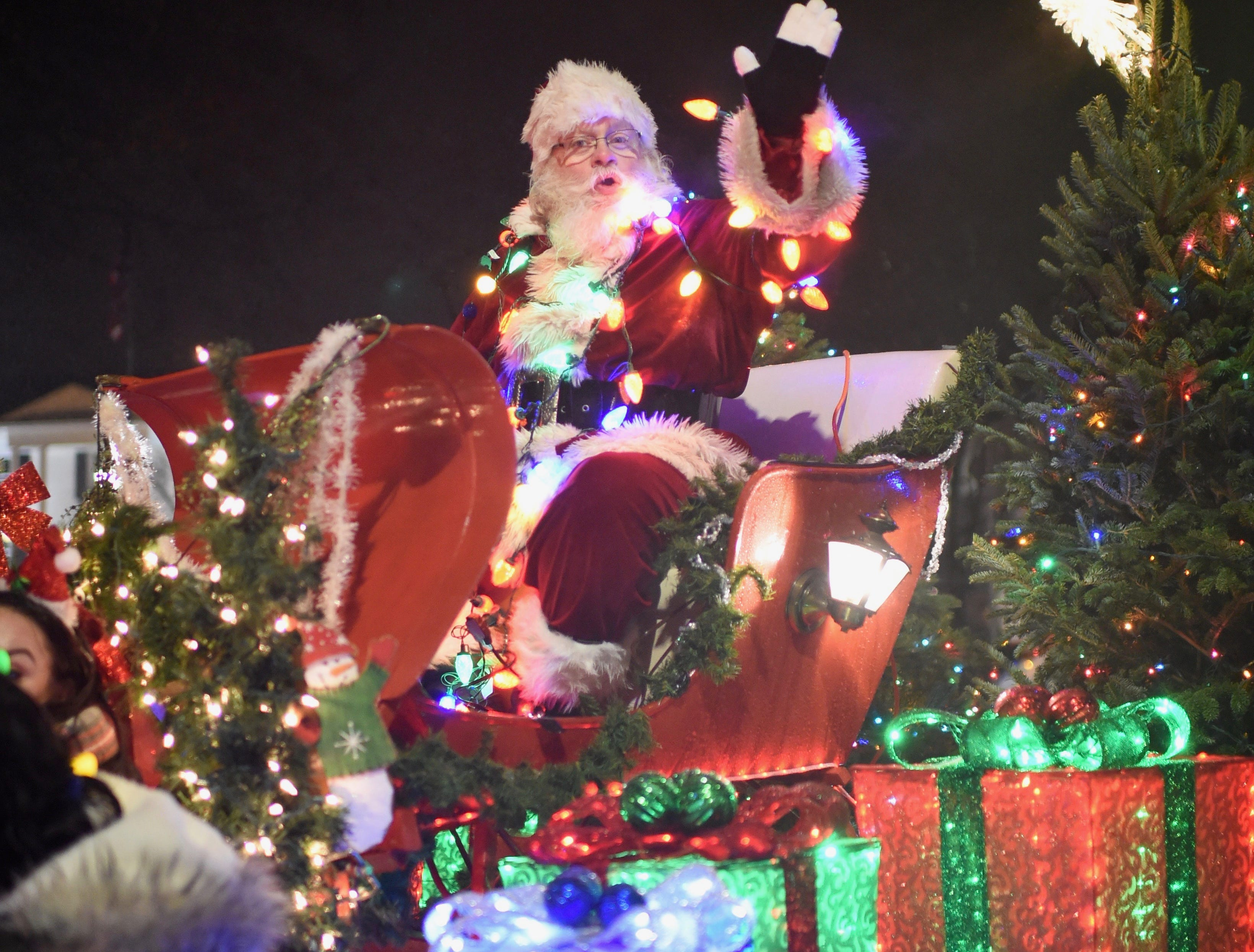 """Santa arrives in downtown Farmington during the """"Light up the Grand"""" parade Saturday evening."""