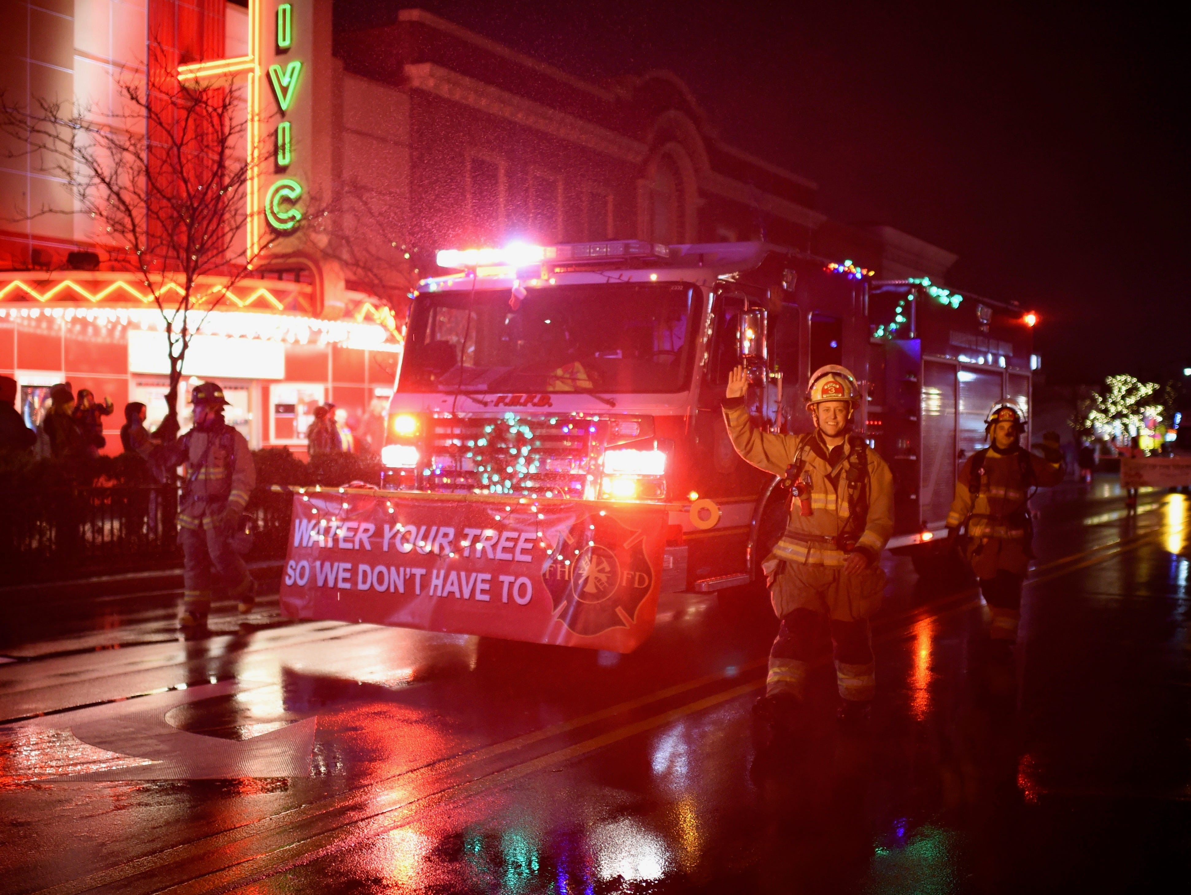 Firefighters from the Farmington Hills Fire Department are in the holiday spirit during the annual parade.