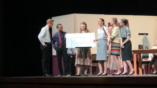 Farmington students Jack Sweeting, Kamar  Scaggs, Maddy Fohey, Lauren Valli, Mackenzie Stark, Maddy Tolonen, and Megan Cromwell discuss the murder case.
