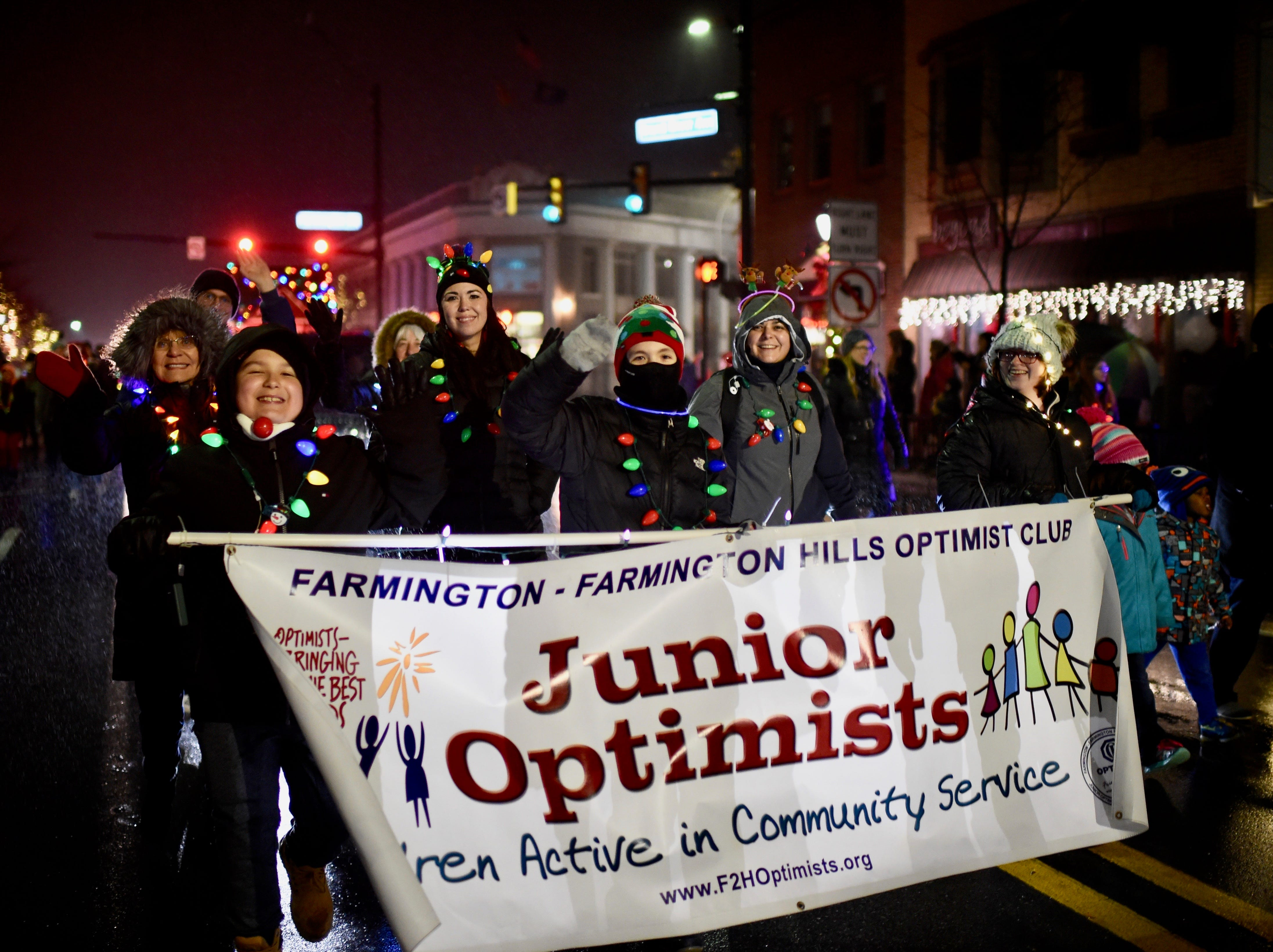 Junior Optimists are in the holiday spirit Saturday evening in downtown Farmington.