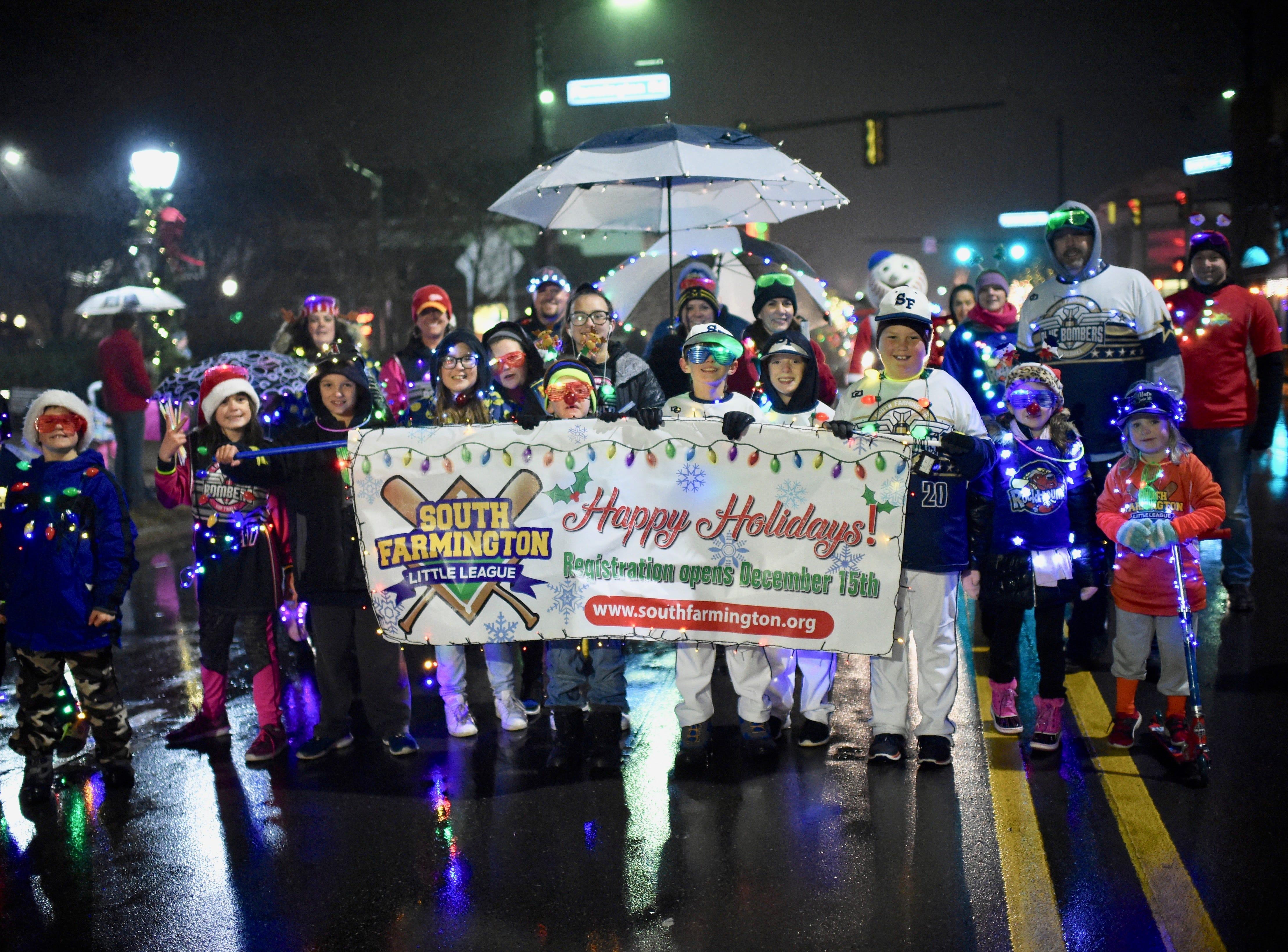 South Farmington Little League members take part in this year's parade in Farmington.