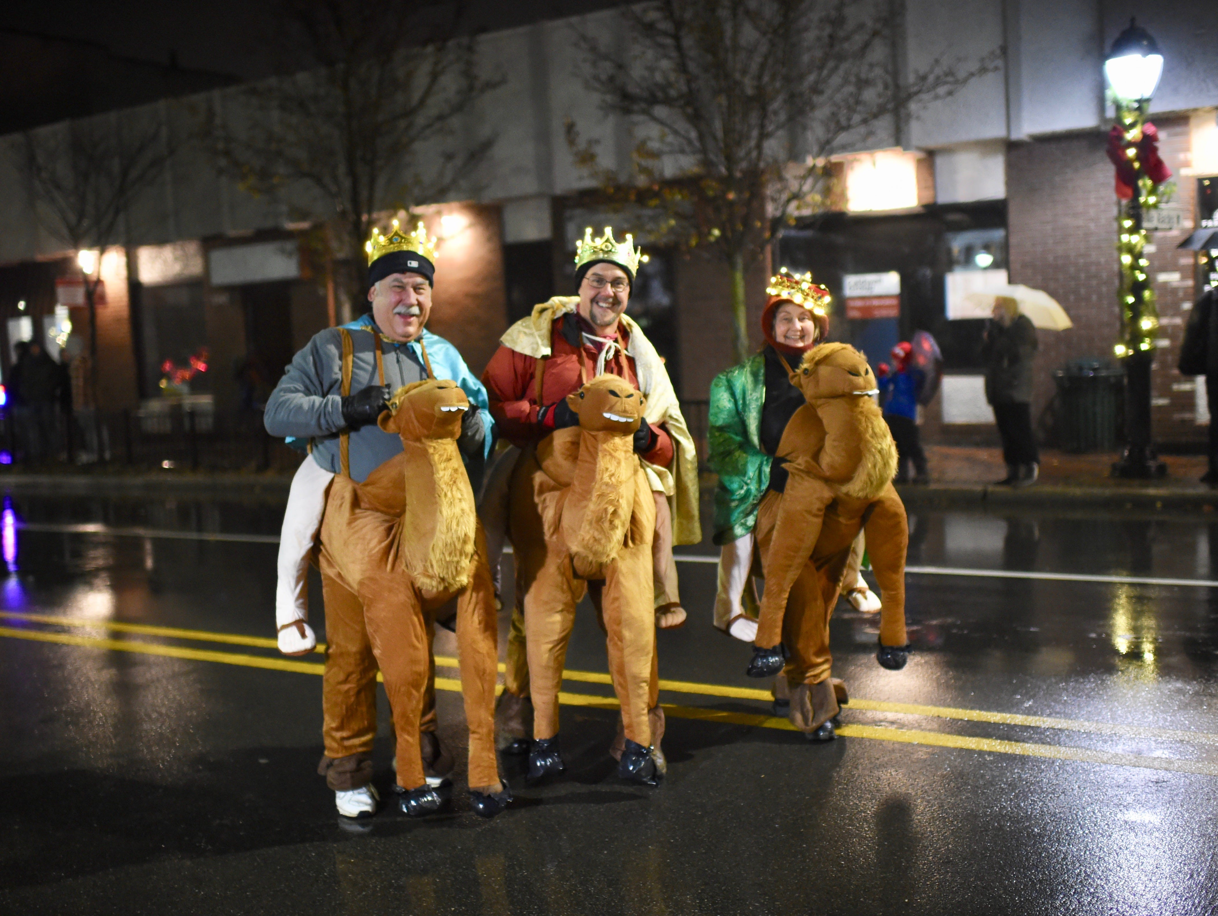 Two wise men and a wise lady take part in the annual parade in Farmington.