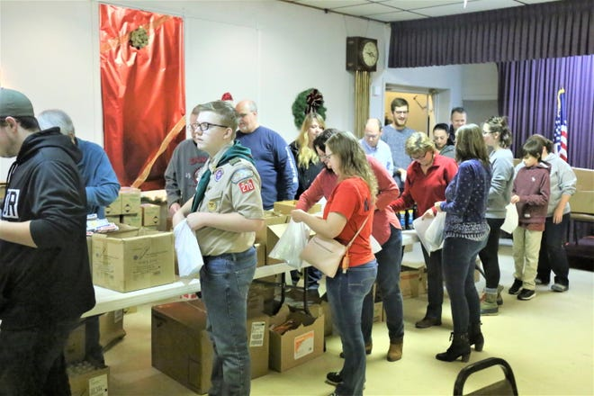 Community members, Boy Scouts, Elks and others joined in packaging some 850 gifts for veterans.