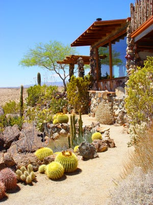 Detailing the edges of stone and cactus make this pathway integral with the landscape.