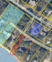 This image from the Santa Rosa County property appraiser's website (with red lines added by the PNJ) shows the properties in question at the end of Catawba Street.