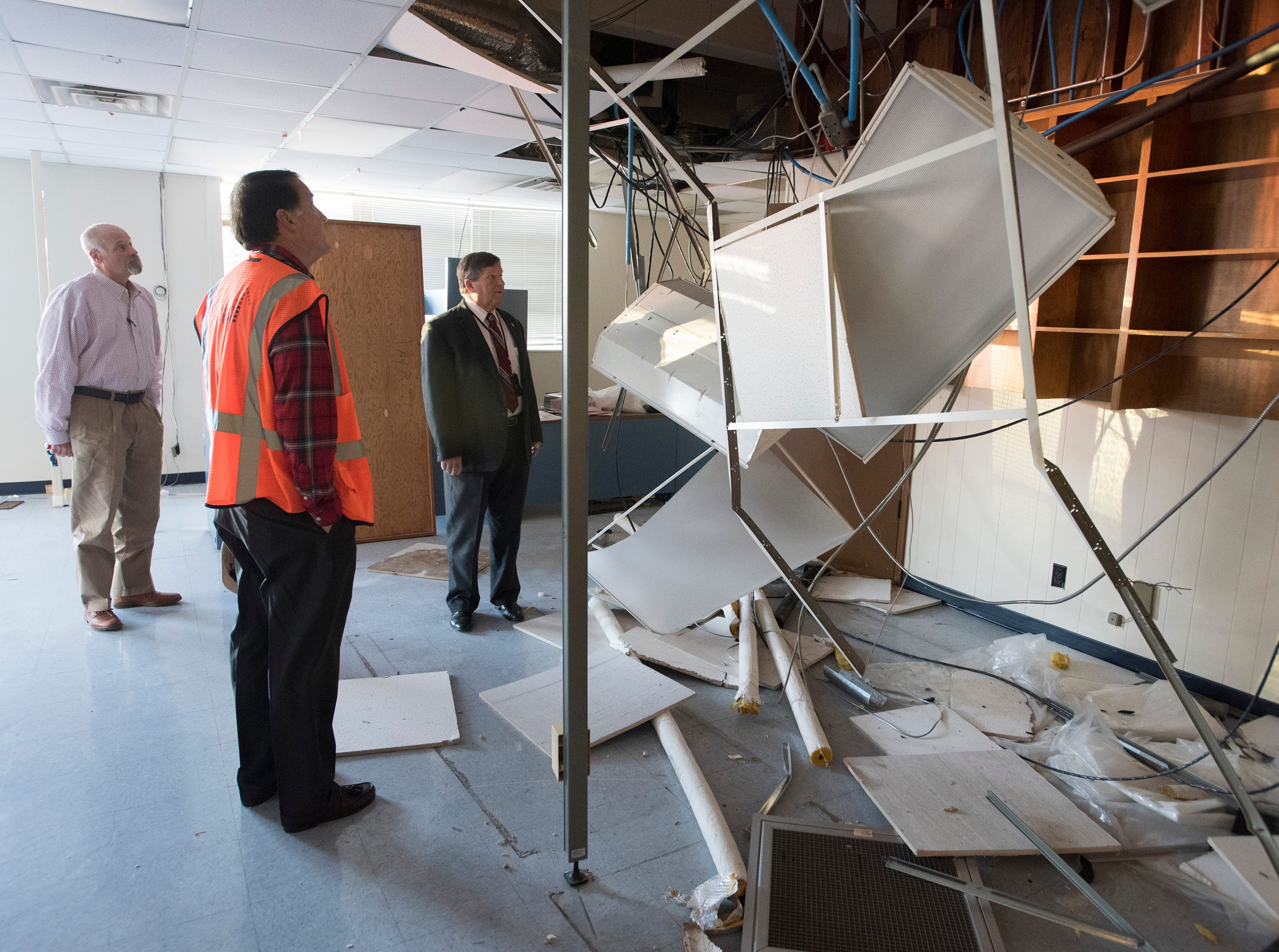 Real Estate Developer, Ed Carson, Escambia County School  Realtor, Danny Zimmern, and Superintendent, Malcolm Thomas, inspect the damage to the building from vandals during a tour of the old district headquarters building on Garden Street on Tuesday, Dec. 4, 2018. Developers want to build a 280-unit apartment complex on the school district site.