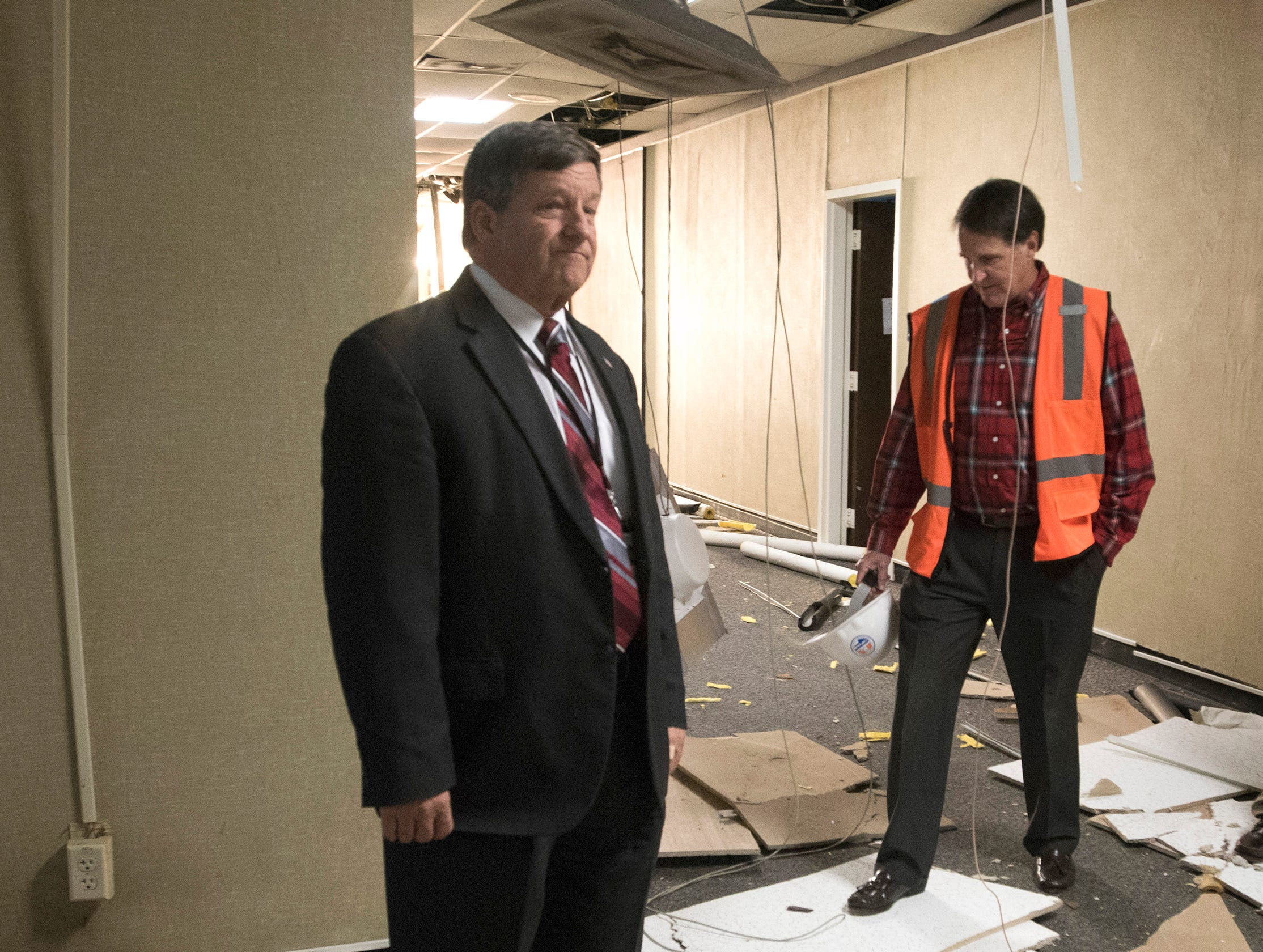Escambia County School Superintendent,  Malcolm Thomas, and Developer, Ed Carson tour the old district headquarters building on Garden Street on Tuesday, Dec. 4, 2018. Carson and a group of developers want to build a 280-unit apartment complex on the school district site.