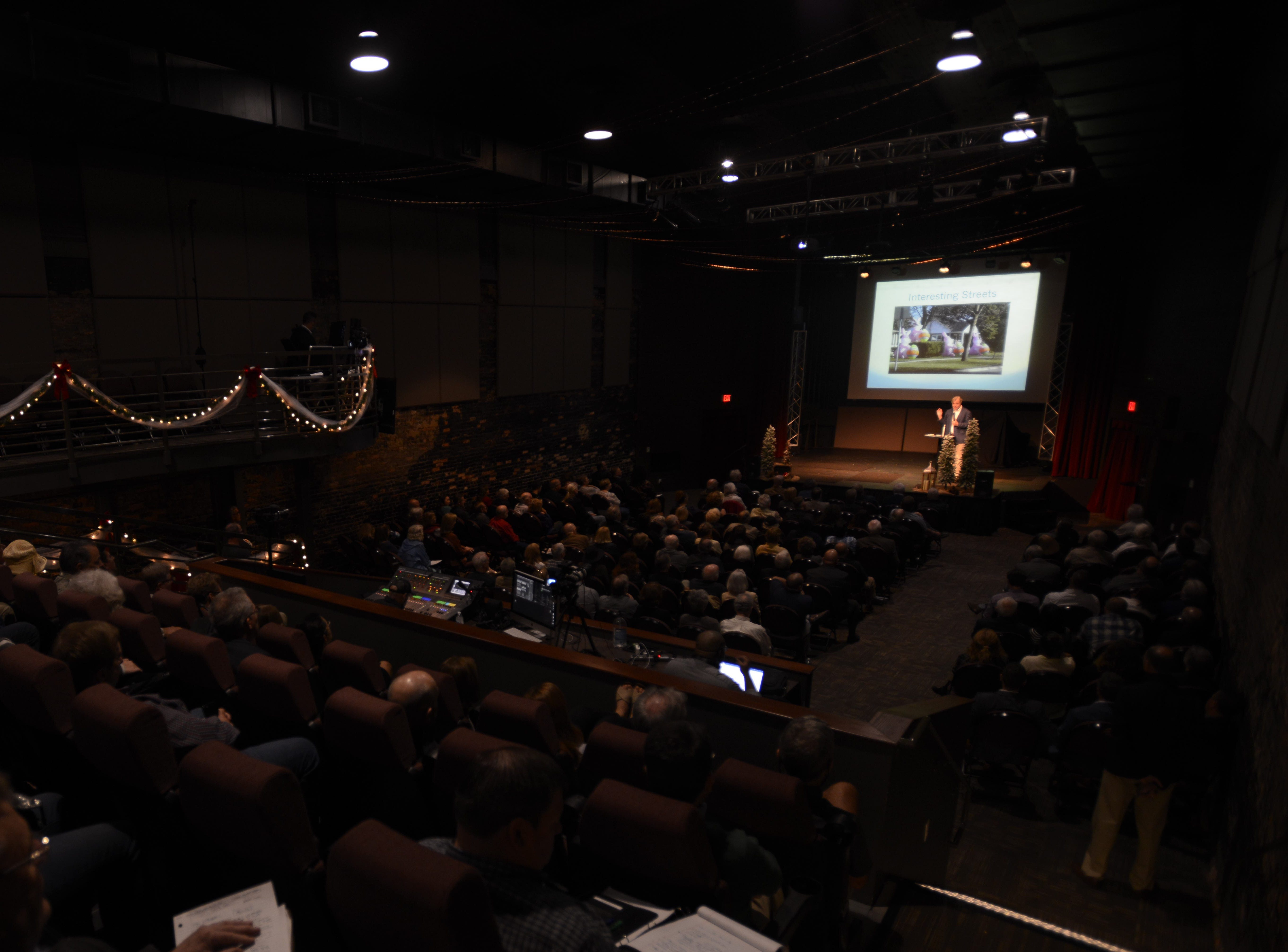 Hundreds of people pack into the REX Theatre in downtown Pensacola on Monday, Dec. 3, 2018, for a presentation by CivicCon speaker Jay Walljasper.