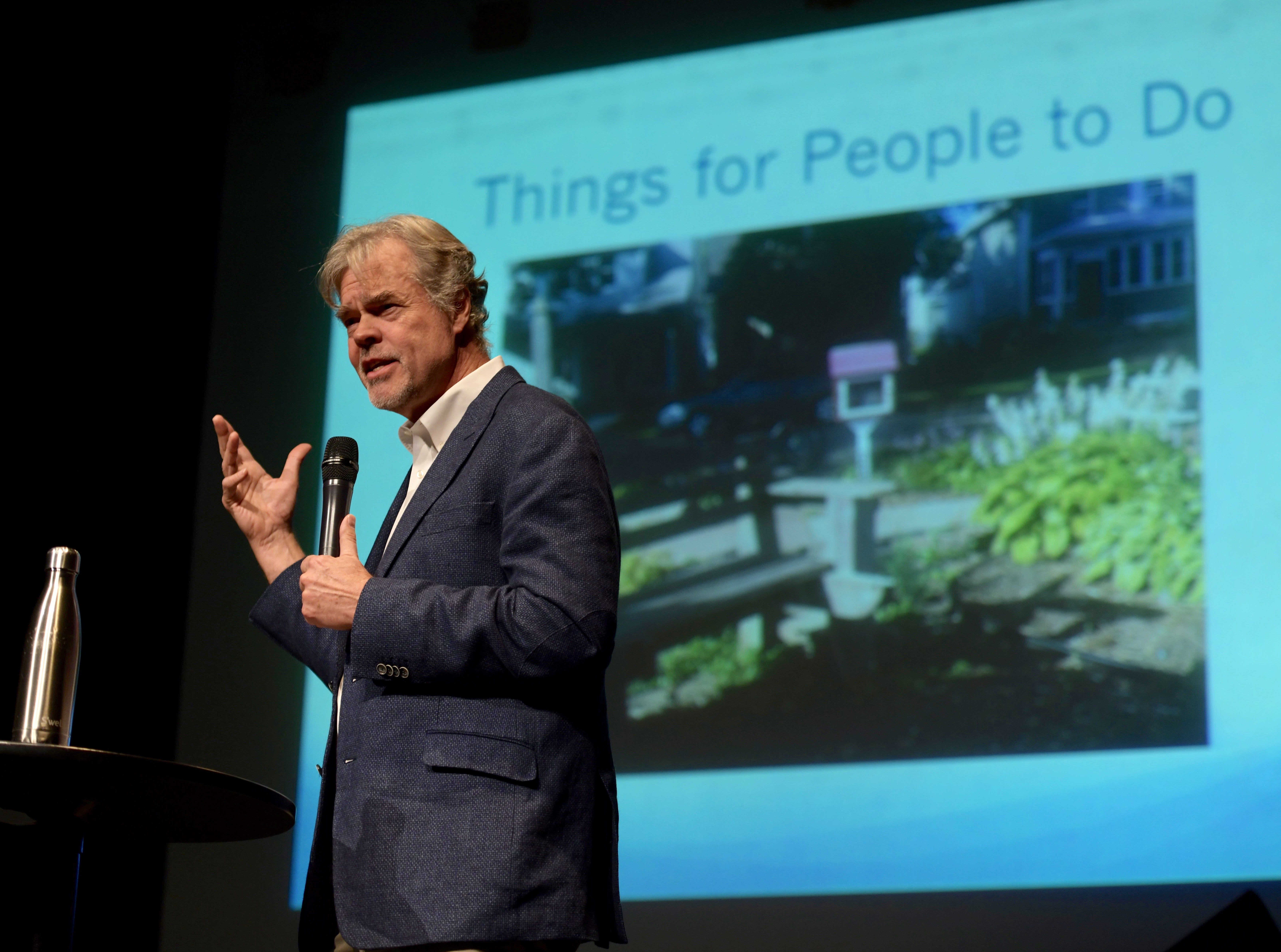 Author and speaker Jay Walljasper, an urban writer-in-residence at Augsburg College in Minneapolis and senior fellow at the Project for Public Spaces, speaks Monday, Dec. 3, 2018, at the REX Theatre in downtown Pensacola as part of the CivicCon speaker series.