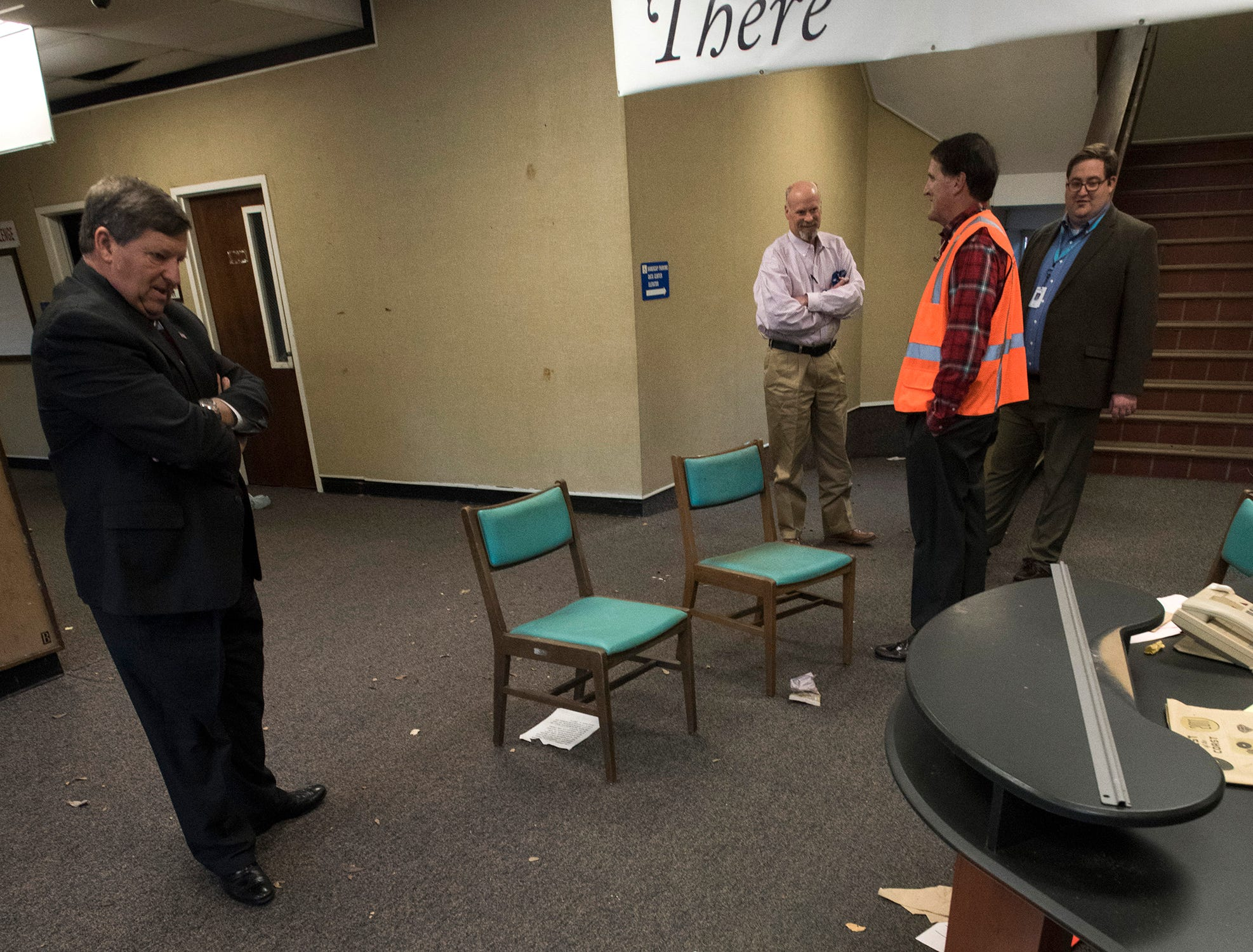 Escambia County School Superintendent,  Malcolm Thomas, Developer, Ed Carson, and Realtor Danny Zimmern, gives Pensacola News Journal Reporter Jim Little a tour of the old district headquarters building on Garden Street on Tuesday, Dec. 4, 2018. Developers want to build a 280-unit apartment complex on the school district site.