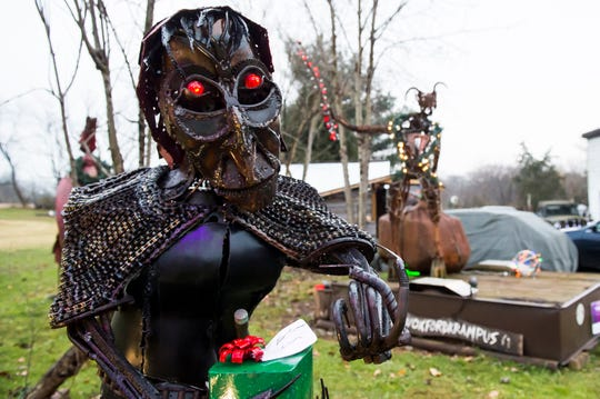 Sculpture artist Jeff Asper newest creation, Frau Perchta the German Christmas witch, is made out of several recycled materials including bicycle chain, parts from a Saab 9-3 convertible, pliers and old tractor parts.