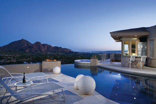 Joel W. Nomkin, an attorney practicing in Phoenix, and his wife Betsy, purchased this house in Paradise Valley with negative edge salt water pool, spa, built-in barbecue and a guest pool house. .