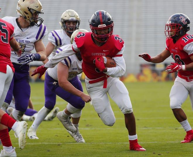 Centennial's Jaydin Young (3) runs for a touchdown against Notre Dame Prep during the 5A state football championship at Sun Devil Stadium December 1, 2018. Centennial won 60-7.