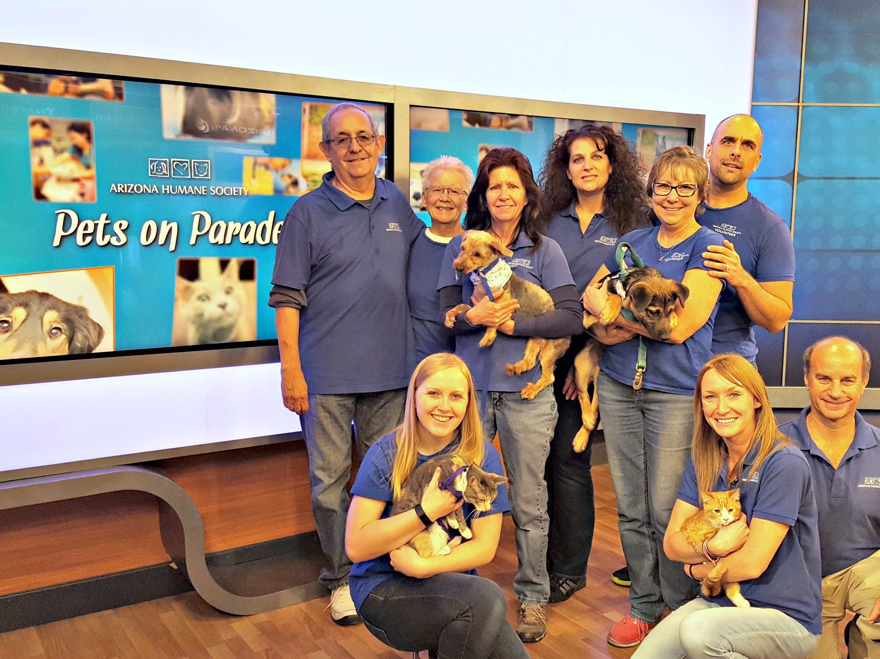 "Former host Ashliegh Goebel poses with the ""Pets on Parade"" crew."