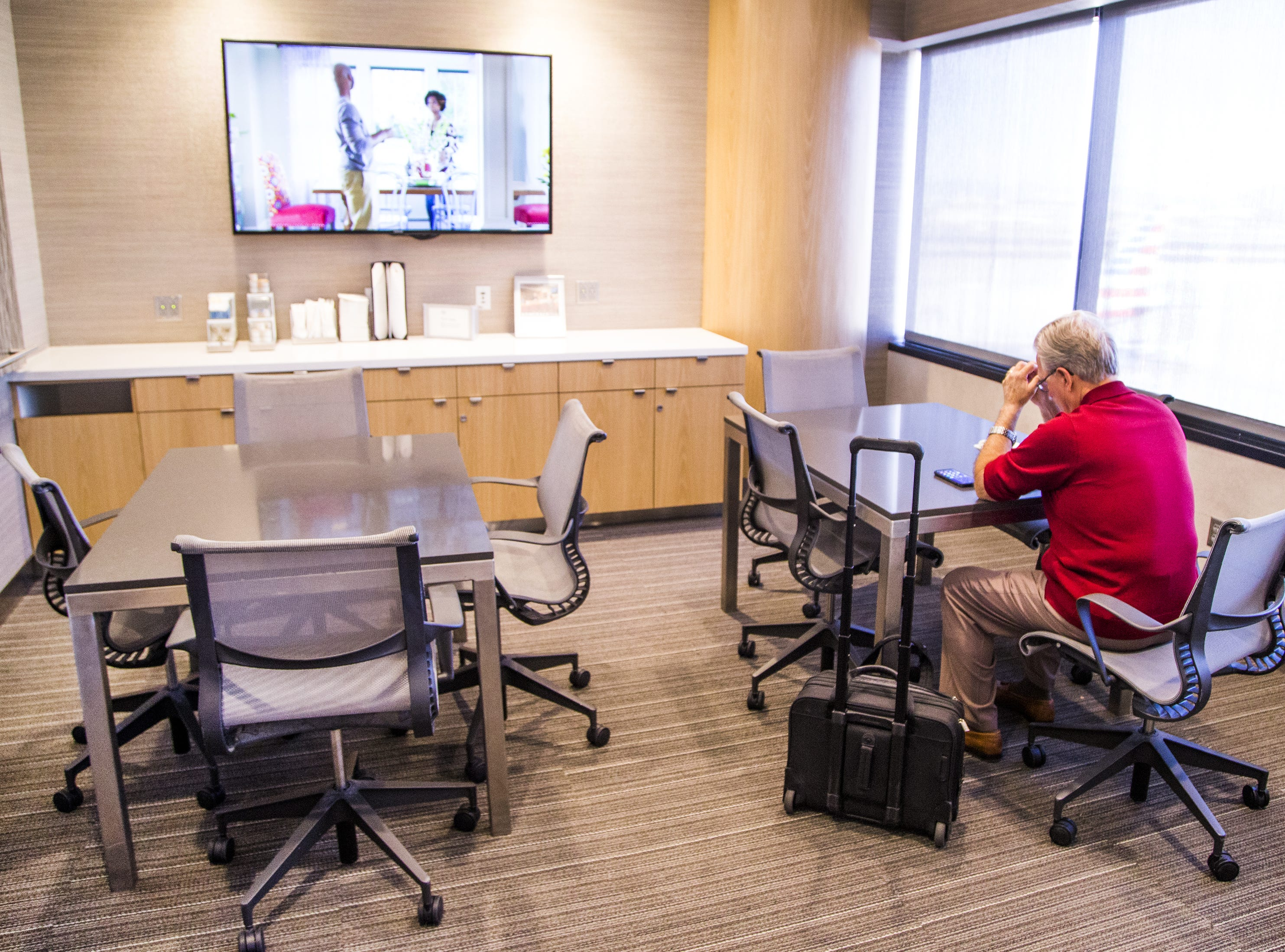 A customer relaxes in the meeting room inside the American Airlines Admirals Club in Terminal 4 at Sky Harbor International Airport, Wednesday, October 31, 2018.