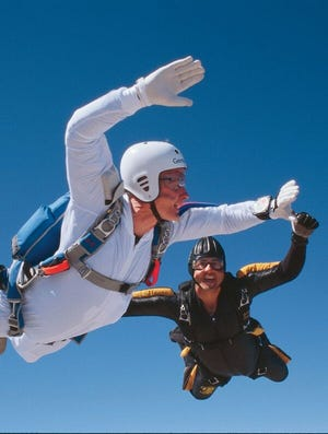 President George H. W. Bush, 72, was all smiles when he jumped from a plane, this time for fun, on March 25, 1997 at the Army Proving Ground in Yuma, Ariz., with jump master Andy Serrano.