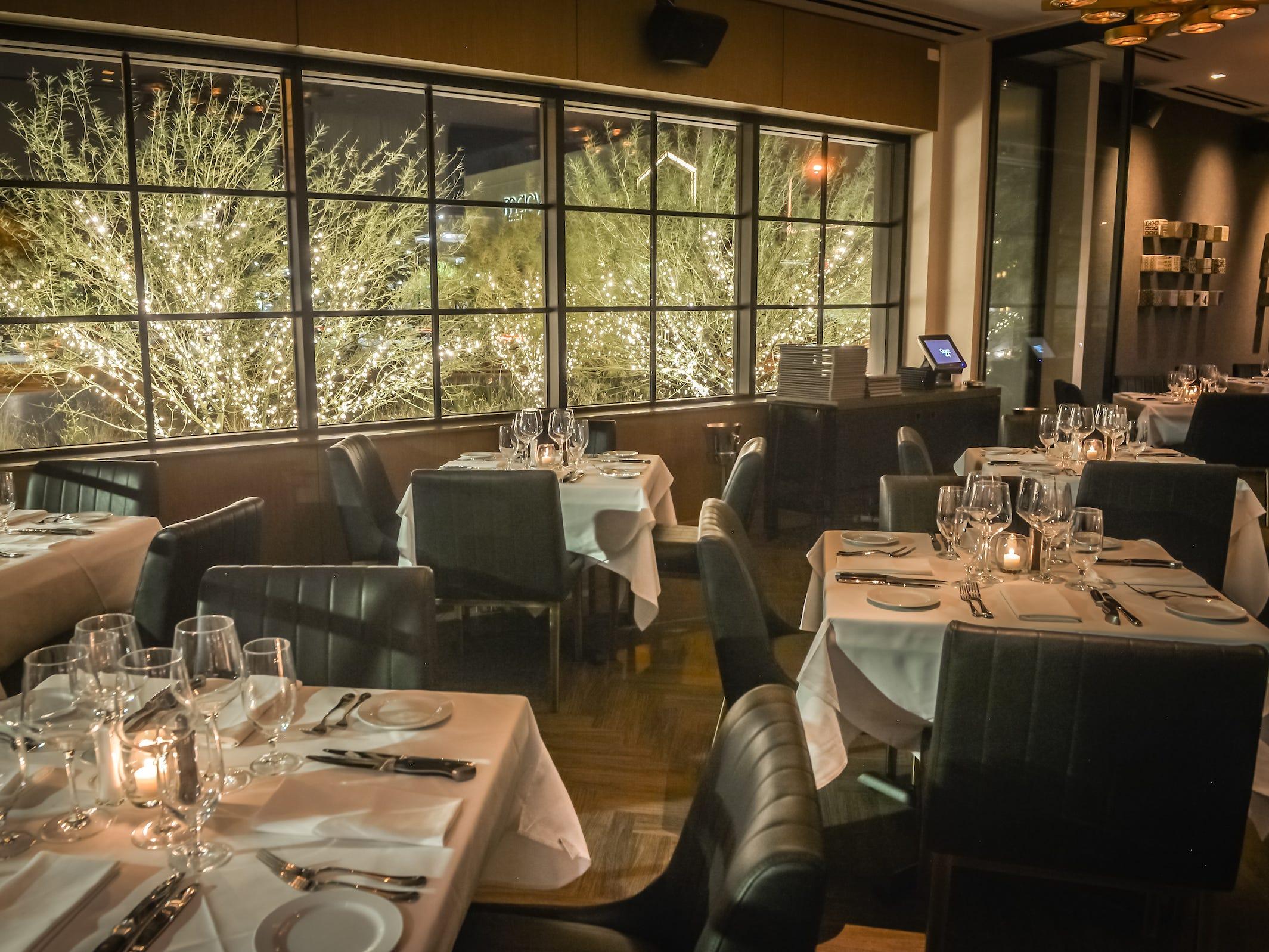 Tables near the windows inside Ocean 44 in Scottsdale.