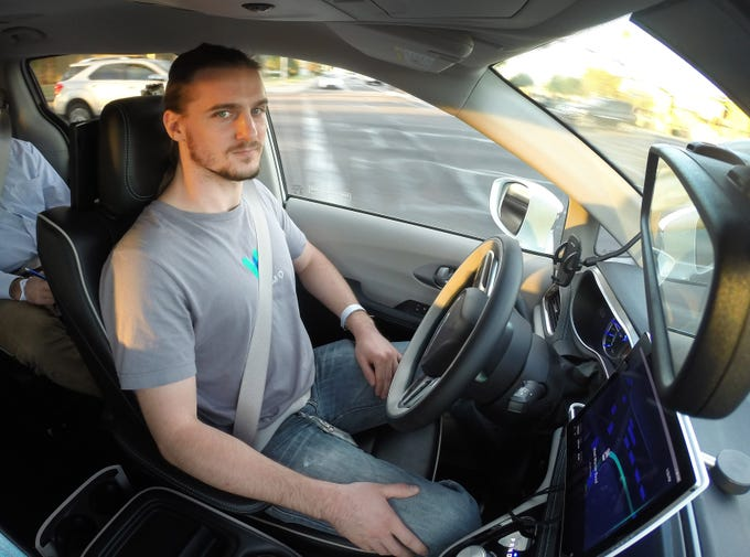 Waymo Safety driver Derek Sirakis monitors a self-driving car Nov. 28, 2018, during a demonstration ride in Chandler, Ariz. Tempe, Mesa, Chandler and Gilbert will be the first cities in the world with Waymo One self-driving service.