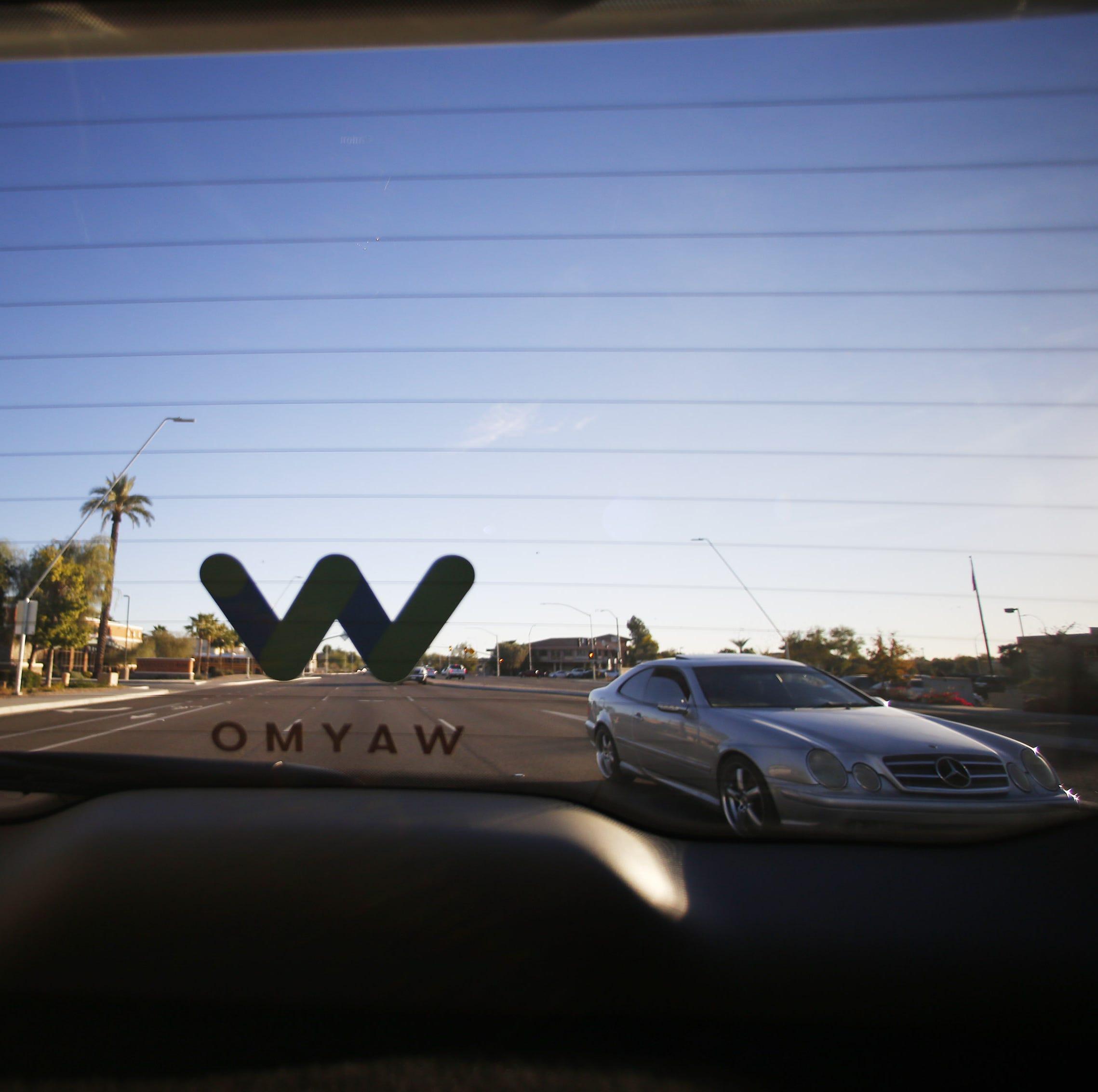 Traffic is shown behind a Waymo self-driving car...