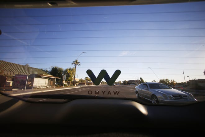 Traffic is shown behind a Waymo self-driving car Nov. 28, 2018,  during a demonstration ride in Chandler.