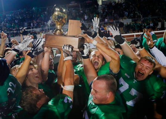 Thatcher celebrates winning the 2A state championship football game against Round Valley at Campo Verde High School in Gilbert on Nov. 23, 2018.
