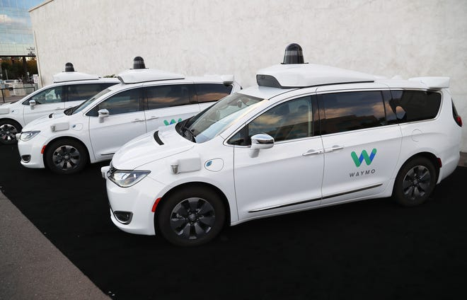 Waymo self-driving cars are seen Nov. 28, 2018, in Chandler.