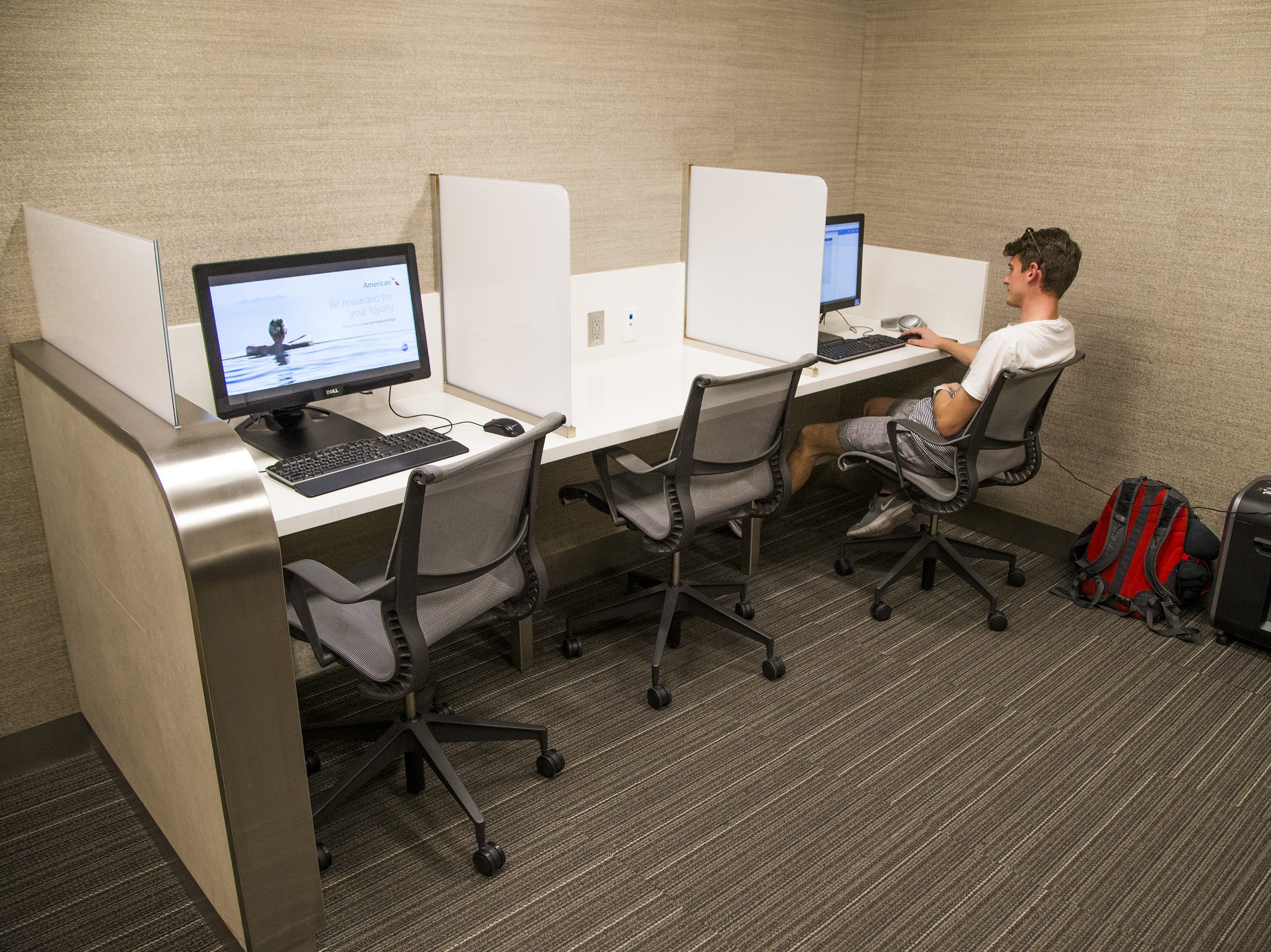 Curt Forrester of Waco, Texas, works in the computer room of the American Airlines Admirals Club in Terminal 4 at Sky Harbor International Airport, Wednesday, October 31, 2018.