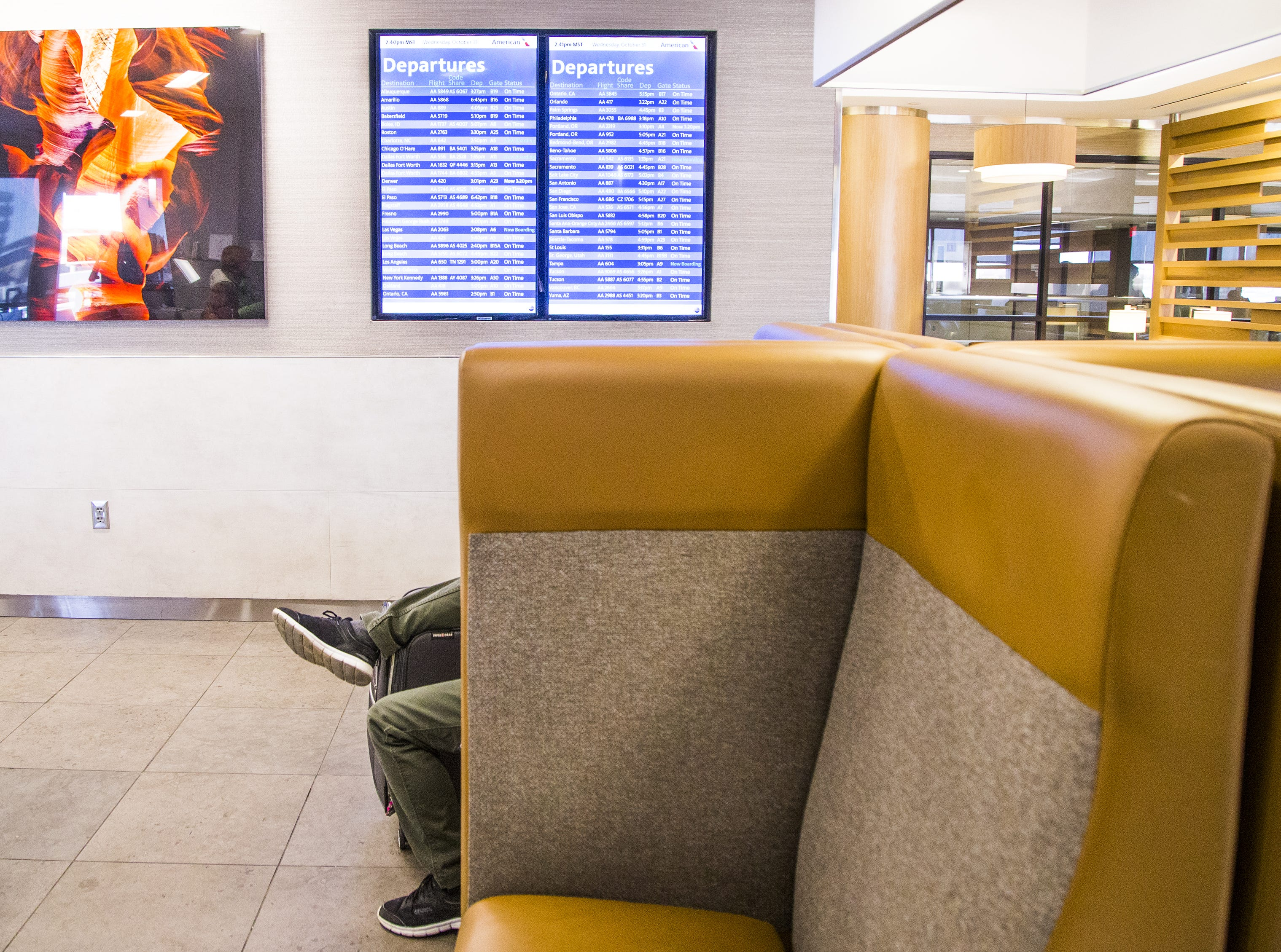 A customer relaxes in the American Airlines Admirals Club in Terminal 4 at Sky Harbor International Airport, Wednesday, October 31, 2018.