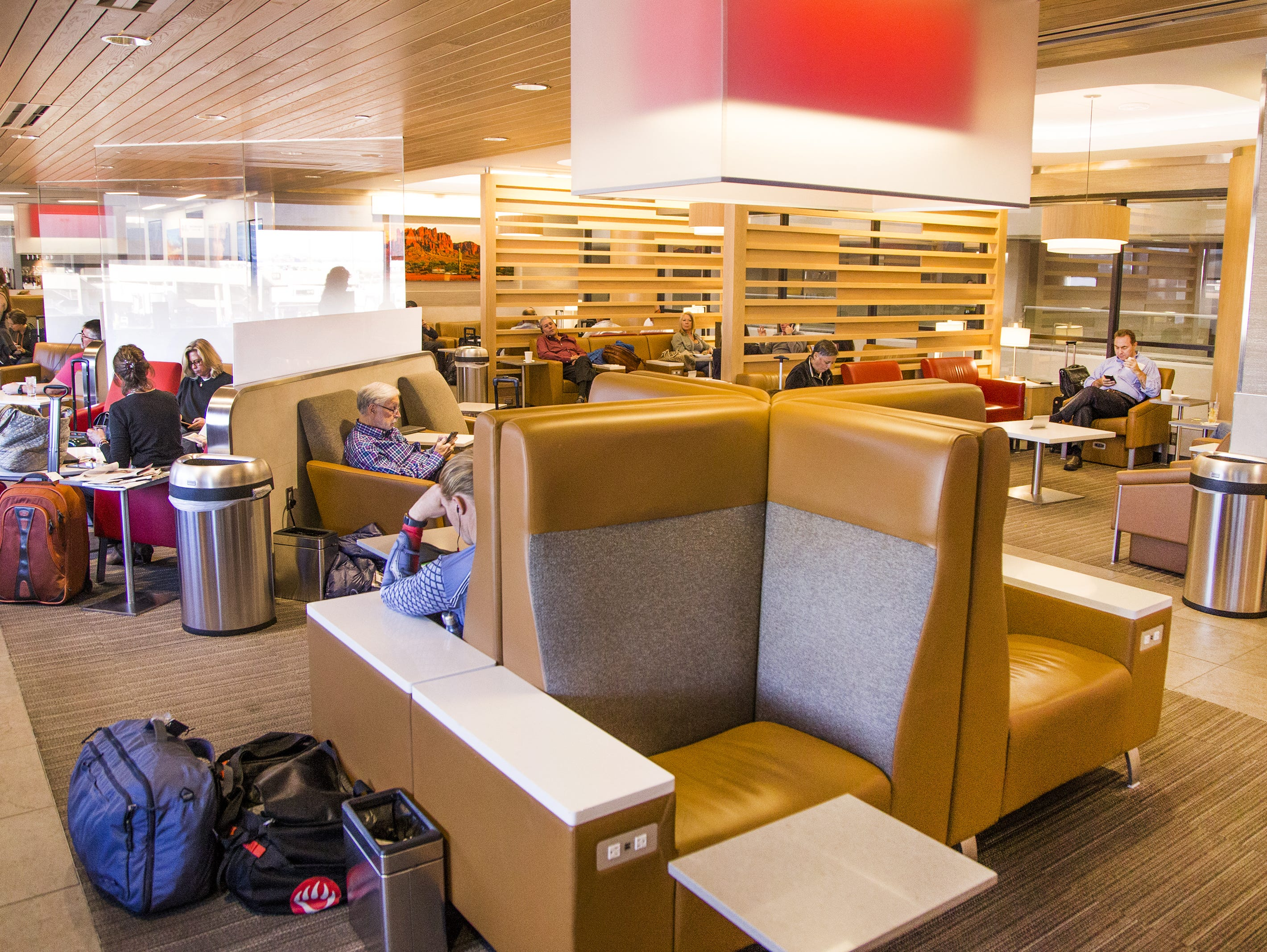 Customers relax in the American Airlines Admirals Club in Terminal 4 at Sky Harbor International Airport, Wednesday, October 31, 2018.