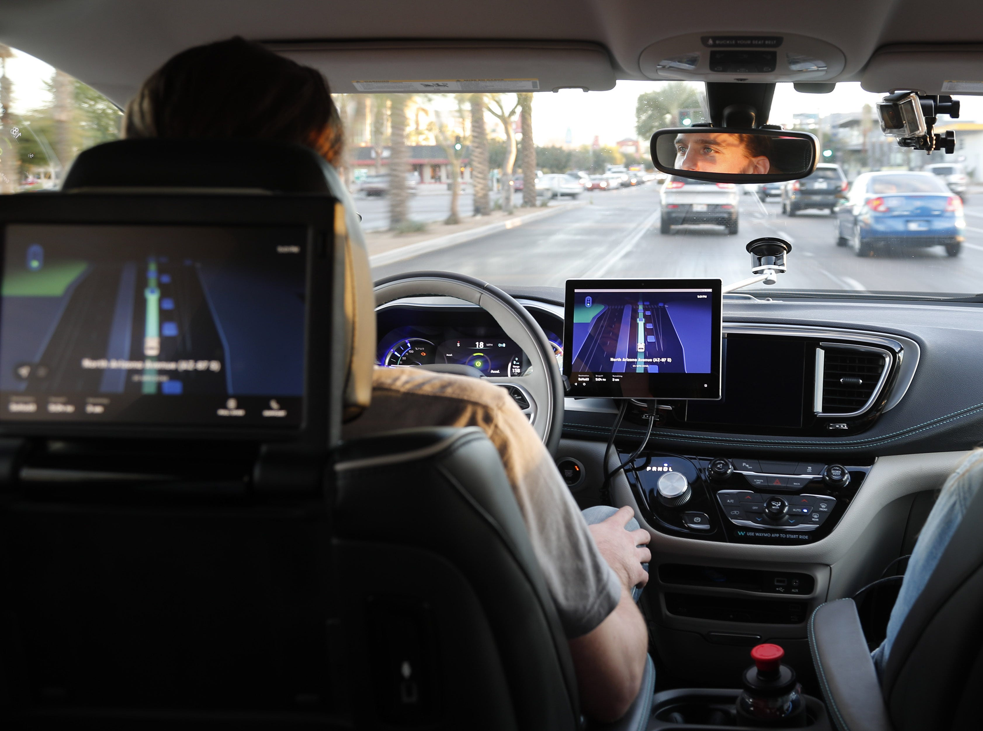Waymo Safety driver Derek Sirakis monitors a self-driving car Nov. 28, 2018, during a demonstration ride in Chandler.  Tempe, Mesa, Chandler and Gilbert will be the first cities in the world with Waymo One self-driving service.
