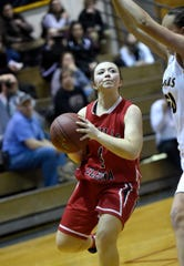 Annville-Cleona's Arianna Clay is blocked at the basket by an Elco defender during a game last season.