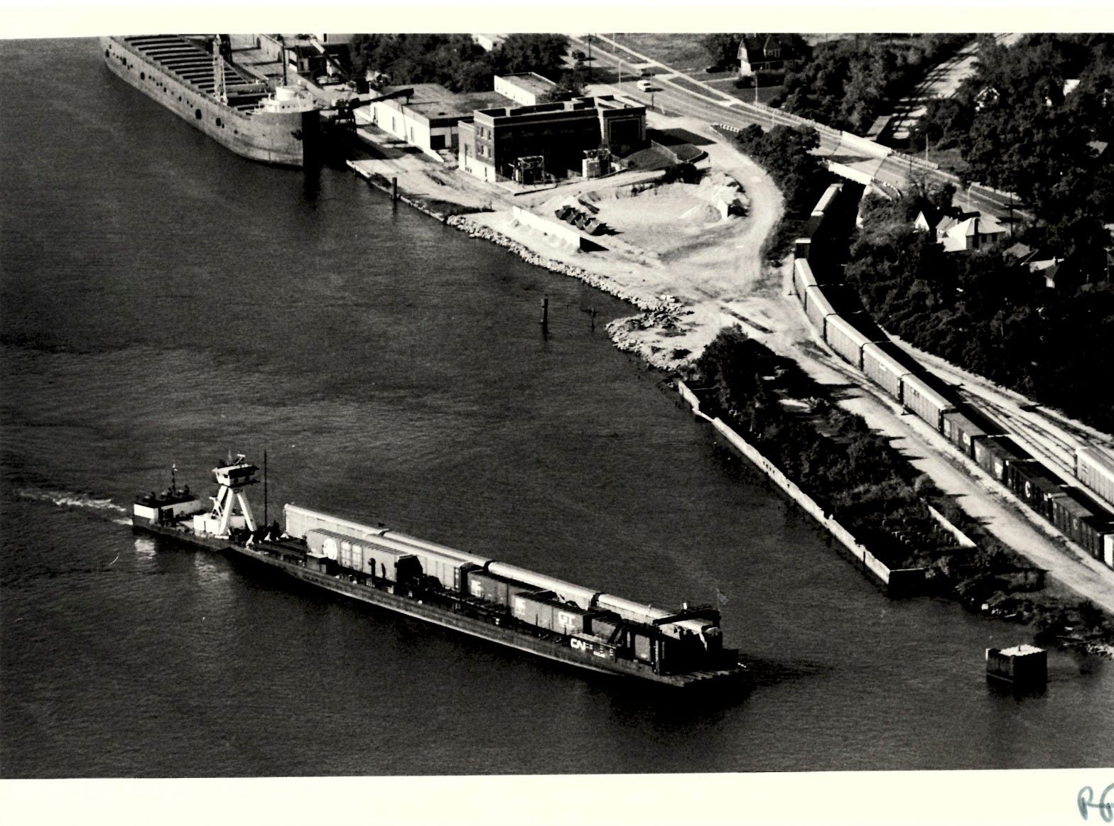 In a photo dated 1984, a car ferry carrying train cars from Sarnia passes the Seaway Terminal in Port Huron on its way to the CSX and Grand Trunk Western railyards in Port Huron.
