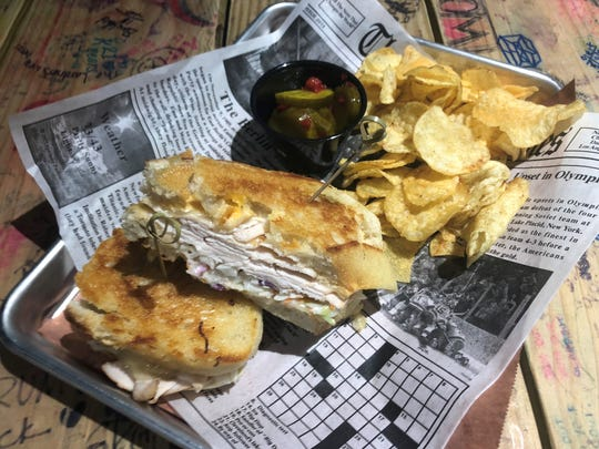 A turkey reuben sandwich served on sourdough with chips and house pickles — an example dish at War Water Brewery's Wicked Awesome Eats in St. Clair.
