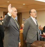 Steven Schwartz, left, raises his hand to be sworn in before Dutchess County Court Judge Peter Forman on Dec. 4, 2018. Schwartz, joined by his attorney Joseph Tock (right), pleaded guilty to one felony count of possessing a sexual performance by a child.