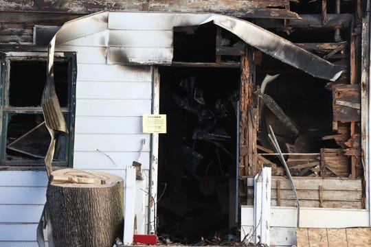 The back door at 61 Academy Street in the City of Poughkeepsie on December 4, 2018. A fire early on Monday severely damaged the property and claimed the lives of 4 inhabitants.