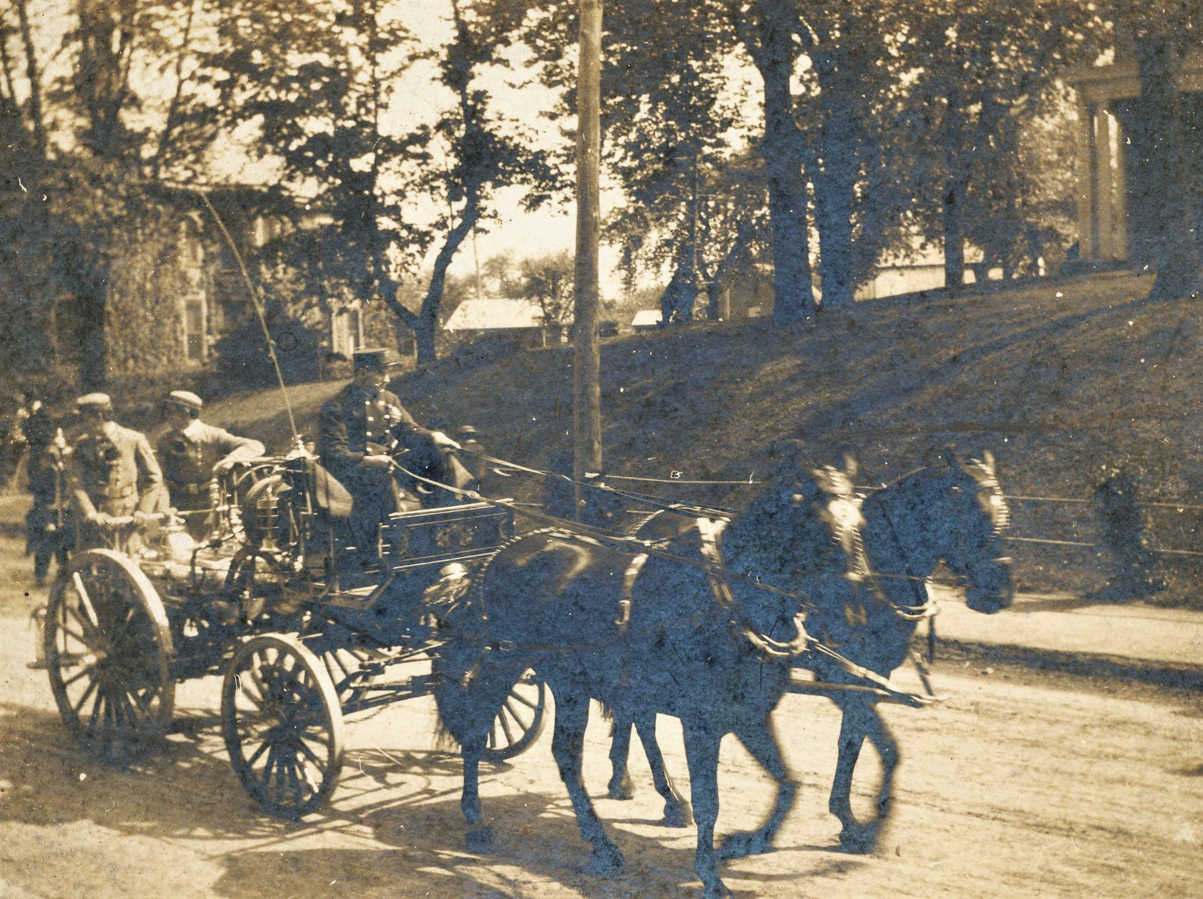 The two black horses pulling the 1902 Holloway Chemical Wagon of the Junior H. & T. Co. No. 2 on North Main Street in Chambersburg.