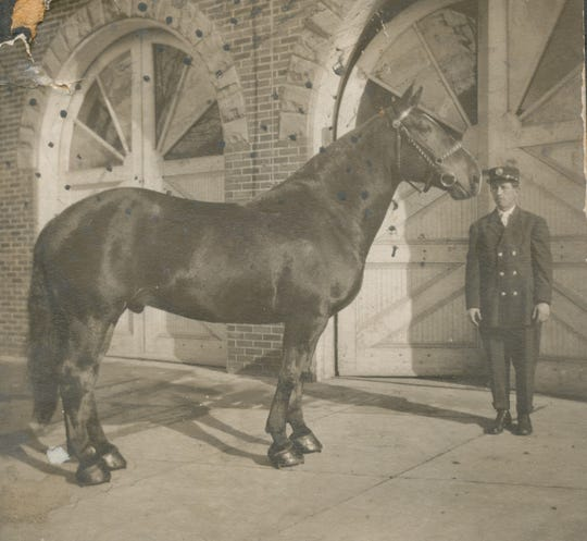 Franklin Fire Company's horse Frank with a member in front of their fire house on North Franklin Street in the early 1900s.