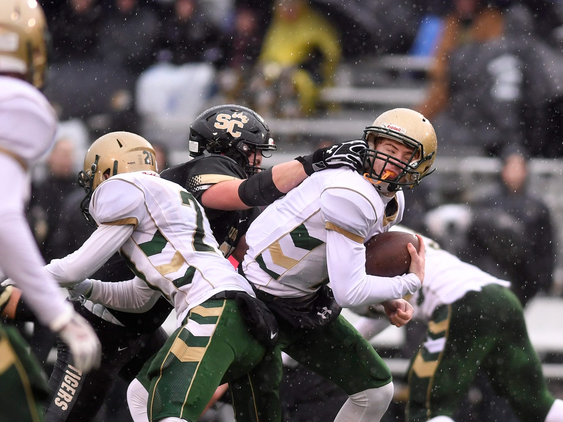 York Catholic quarterback Mitchell Galentine is facemasked by Payton Pursel of Southern Columbia during the PIAA Class 2-A quarterfinal football game in Shamokin, Saturday, November 24, 2018. John A. Pavoncello photo
