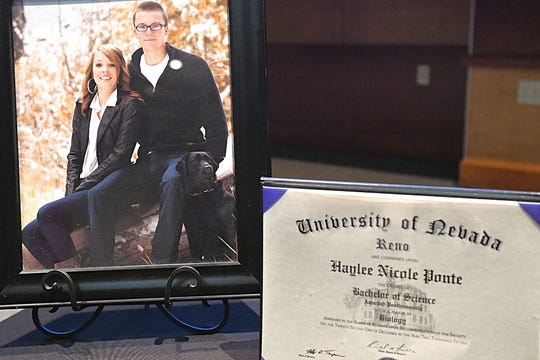 A framed photo of Haylee Ponte and her brother on a table next to a plaque of her bachelors degree from the University of Nevada, Reno. Ponte died at 19 in 2015. She registered as an organ donor and a portrait of her will be featured in the Rose Parade in January.