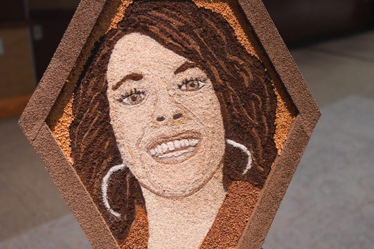 A portrait of Haylee Ponte, who died at 19 from an asthma attack in 2015. The portrait, which is made from ground coffee and spices, will be featured in the Rose Parade in January.