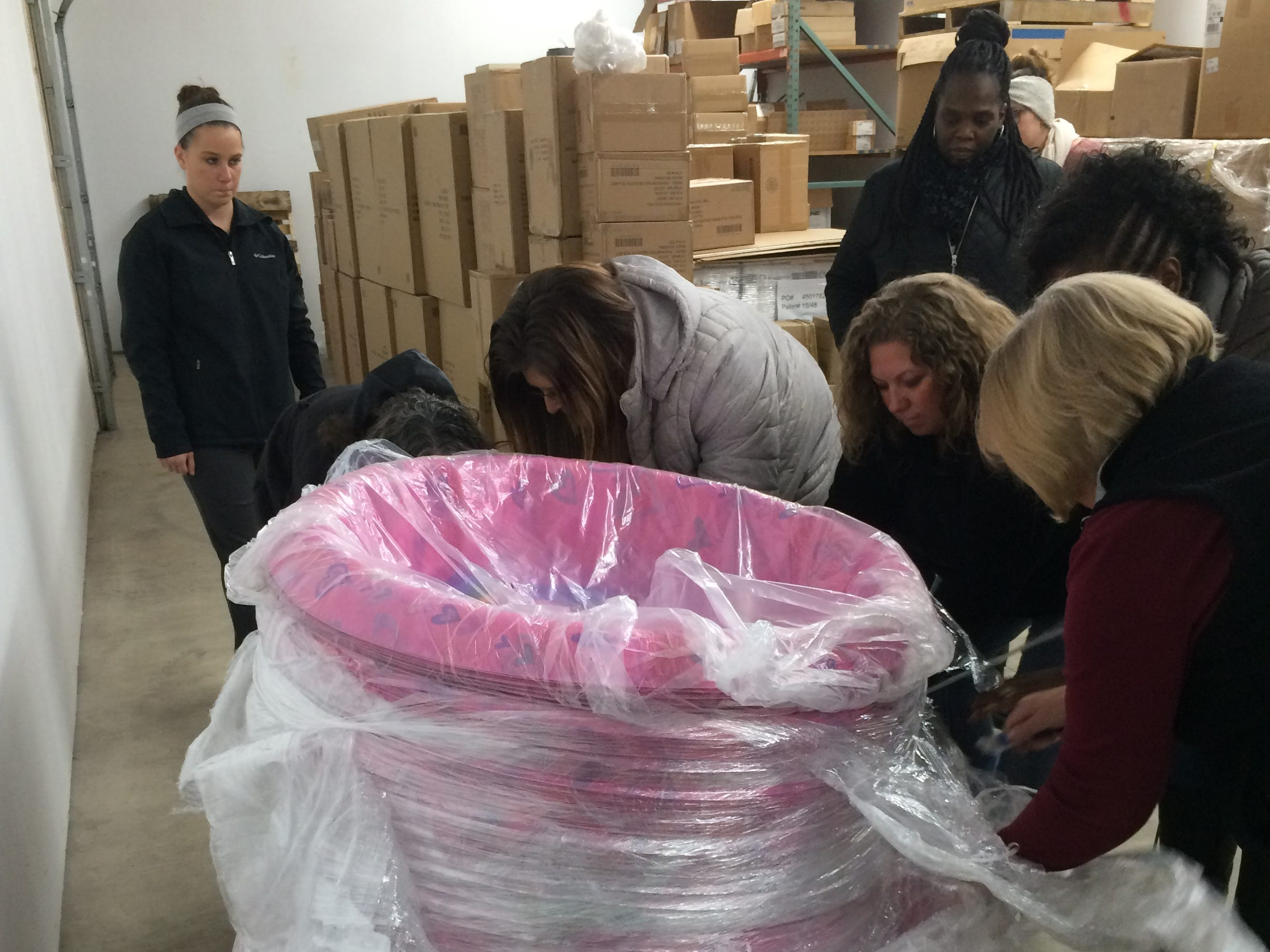 Personnel from Richmond Police Department and the Department of Child Services break down pallets of donated toys Tuesday.